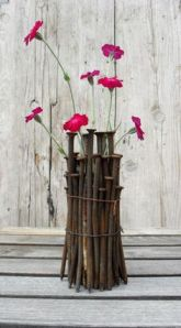 Flower holder/vase made out of nails.